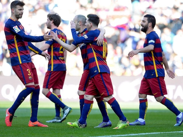 Barcelona players celebrate Getafe's own goal during the La Liga game between Barcelona and Getafe on March 12, 2016