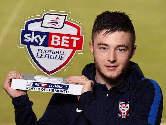Bradley 'John Simm with a beard' Fewster poses with his player of the month award for February 2016