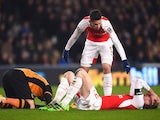 Gabriel tends to Per Mertesacker during the FA Cup game between Hull City and Arsenal on March 6, 2016