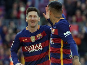 Lionel Messi celebrates scoring with Neymar during the La Liga game between Barcelona and Getafe on March 12, 2016