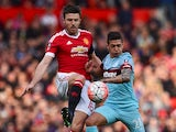 Michael Carrick and Manuel Lanzini in action during the FA Cup game between Manchester United and West Ham United on March 13, 2016