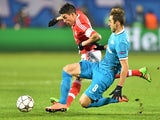 Nicolas Gaitan and Mauricio in action during the thrilling Champions League game between Zenit and Benfica on March 9, 2016
