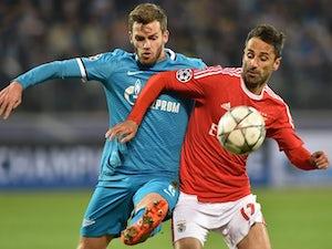 Benfica sneak through to last eight