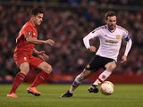 Philippe Coutinho and Juan Mata in action during the Europa League game between Liverpool and Manchester United on March 10, 2016