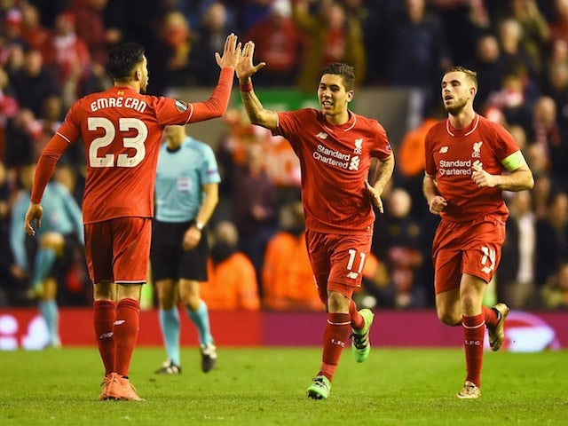 Roberto Firmino celebrates with Emre Can during the Europa League game between Liverpool and Manchester United on March 10, 2016