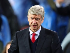 Arsene Wenger looks on prior to the Champions League round-of-16 second leg between Barcelona and Arsenal on March 16, 2016