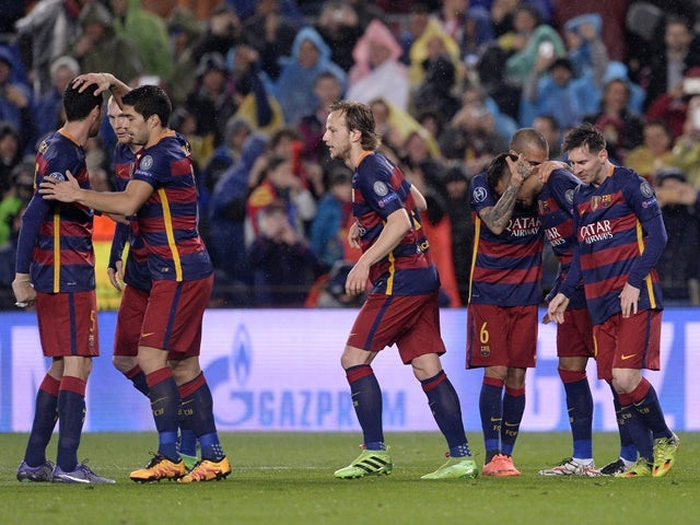 Barcelona players celebrate during the Champions League round-of-16 second leg against Arsenal on March 16, 2016