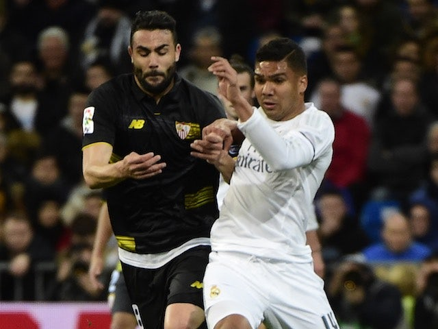 Casemiro and Iborra in actione during the La Liga game between Real Madrid and Seville on March 20, 2016