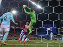 PSV Eindhoven's goalkeeper Jeroen Zoet stops a ball against Atletico Madrid on March 15, 2016