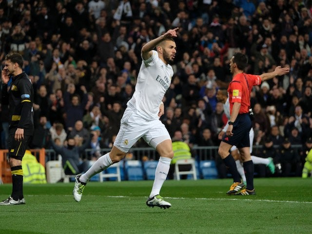 Karim 'To the left, to the left' Benzema celebrates during the La Liga game between Real Madrid and Seville on March 20, 2016