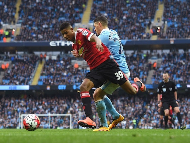 Martin Demichelis of Manchester City challenges Manchester United's Marcus Rashford on March 20, 2016