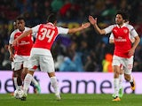Mohamed Elneny celebrates scoring during the Champions League round-of-16 second leg between Barcelona and Arsenal on March 16, 2016