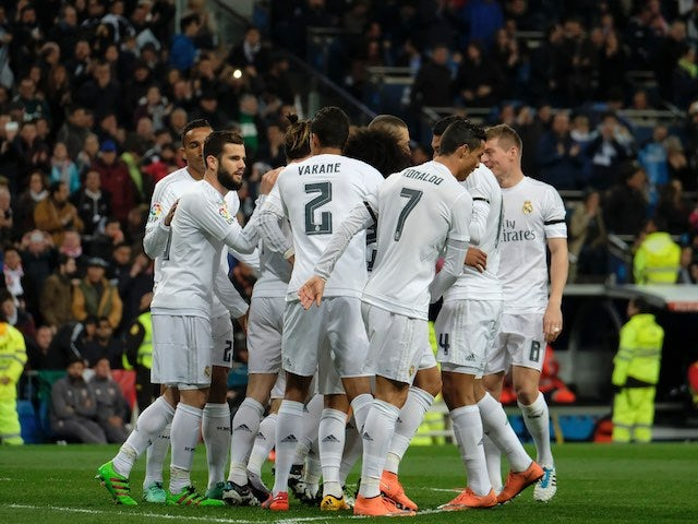 Real Madrid players celebrate scoring during the La Liga game between Real Madrid and Seville on March 20, 2016