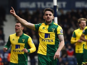 Norwich climb out of relegation zone