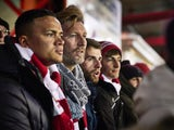 Robbie Savage watches an Accrington Stanley match on March 16, 2016