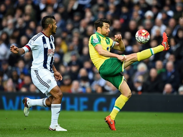 Russell Martin and Salomon Rondon during the Premier League match between West Bromwich Albion and Norwich City on March 19, 2016