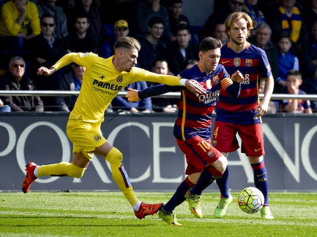 Samuel Castillejo and Lionel Messi in action during the La Liga game between Villarreal and Barcelona on March 20, 2016