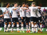 Tottenham Hotspur players celebrate a goal by Harry Kane against Bournemouth on March 20, 2016