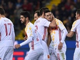 Aritz Aduriz of Spain celebrates a goal with teammates during the international friendly against Italy on March 24, 2016