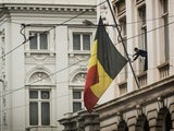 The Belgian flag flies at half mast following the Brussels attacks on March 23, 2016