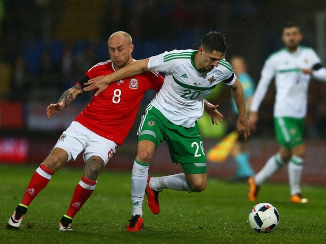 Craig Cathcart of Northern Ireland holds off David Cotterill of Wales during the international friendly match on March 24, 2016