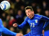 Italy's midfielder Emanuele Giaccherini auditions for Mary Poppins during the friendly against Spain at Friuli-Dacia Arena Stadium in Udine on March 24, 2016