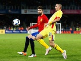 Gerard Pique of Spain battles for the ball with Dragos Grigore of Romania during the International Friendly match between Romania and Spain held at the Cluj Arena on March 27, 2016