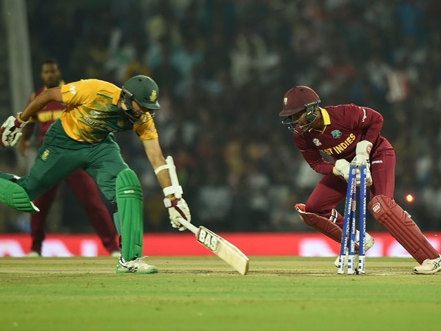 Denesh Ramdin of West Indies successfully runs out South Africa's batsman Hashim Amla during the World T20 on March 25, 2016
