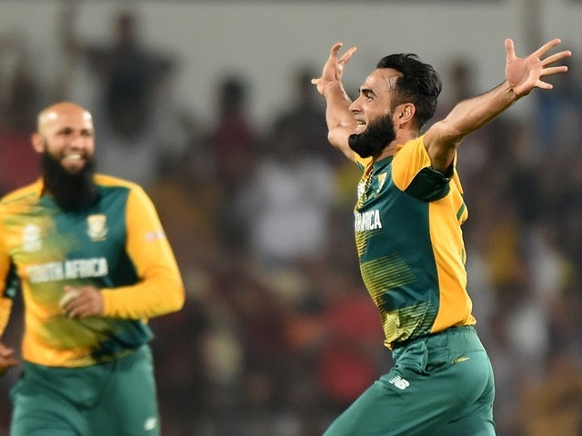 South Africa's bowler Imran Tahir celebrates after taking the wicket of West Indies batsman Darren Sammy on March 25, 2016