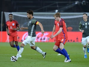 Sami Khedira and Eric Dier in action during the international friendly between Germany and England on March 26, 2016