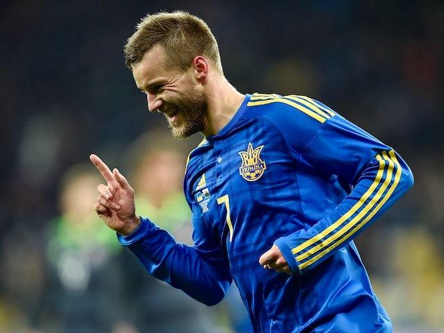 Andriy Yarmolenko celebrates scoring the opener during the international friendly between Ukraine and Wales on March 28, 2016