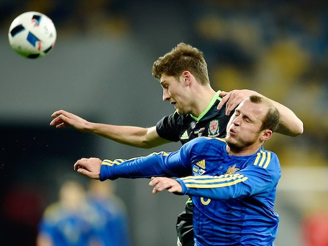 Ben Davies and Roman Zozulya in action during the international friendly between Ukraine and Wales on March 28, 2016