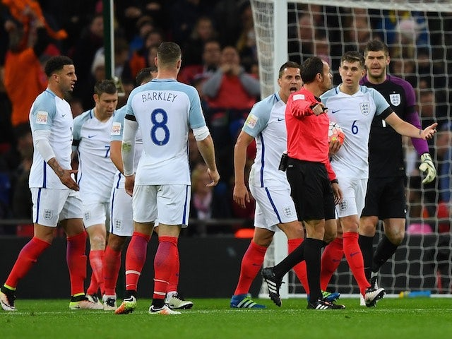 England players complain to the referee during the international friendly against Netherlands on March 29, 2016