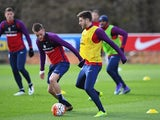 Jamie Vardy and Adam Lallana in action during an England training session on March 28, 2016