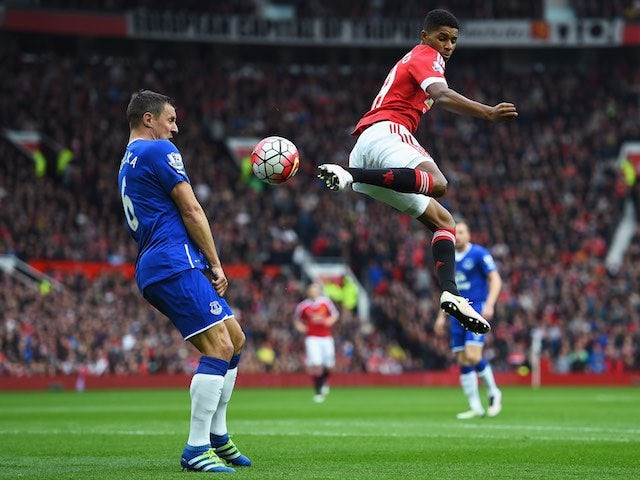 Marcus Rashford and Phil Jagielka during the Premier League match between Manchester United and Everton on April 3, 2016