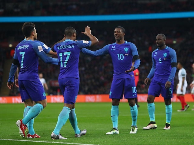 Netherlands players celebrate a goal against England at Wembley on March 29, 2016