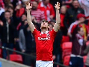 Sam Winnall celebrates scoring during the League Trophy final between Oxford United and Barnsley on April 3, 2016