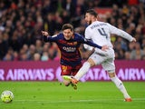 Sergio Ramos flexes his buttocks as Lionel Messi seeks attention during the La Liga match between Barcelona and Real Madrid on April 2, 2016