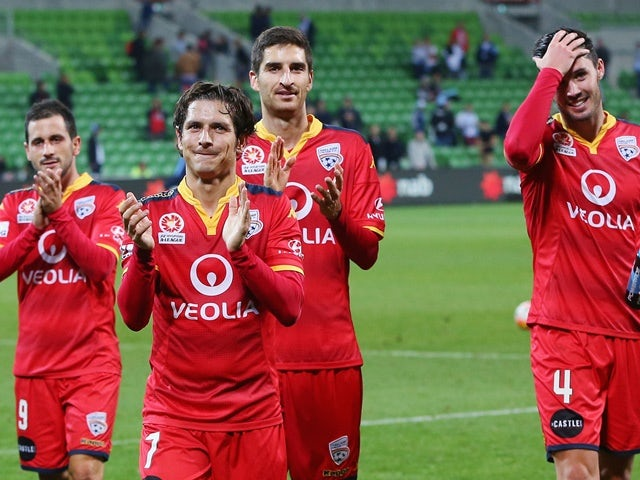 Adelaide United players celebrate winning against Melbourne City on April 8, 2016