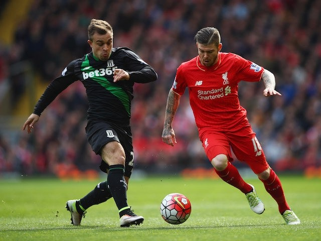 Alberto Moreno and Xherdan Shaqiri in action during the Premier League game between Liverpool and Stoke City on April 10, 2016