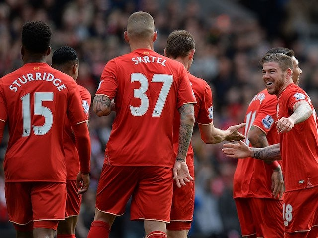 Alberto Moreno celebrates the opener during the Premier League game between Liverpool and Stoke City on April 10, 2016
