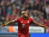 Arturo Vidal celebrates scoring during the Champions League quarter-final between Bayern Munich and Benfica on April 5, 2016
