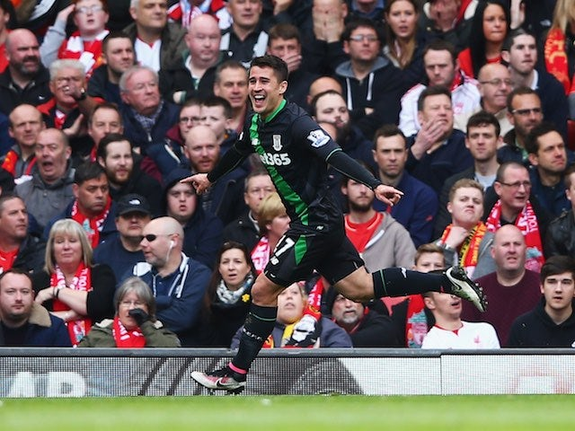 Bojan Krkic celebrates getting an equaliser during the Premier League game between Liverpool and Stoke City on April 10, 2016
