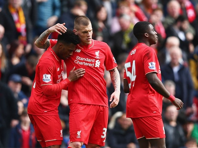 Daniel Sturridge celebrates the second with Martin Skrtel and Sheyi Ojo during the Premier League game between Liverpool and Stoke City on April 10, 2016