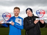 Darrell Clarke and Matty Taylor pose with their League Two manager and player of the month awards for March 2016