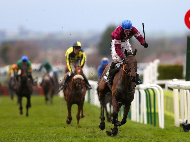 David Mullins rides Rule The World during the Grand National on April 9, 2016