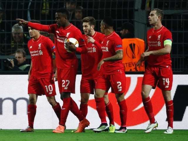 Divock Origi celebrates with teammates after scoring the opener during the Europa League quarter-final between Borussia Dortmund and Liverpool on April 7, 2016