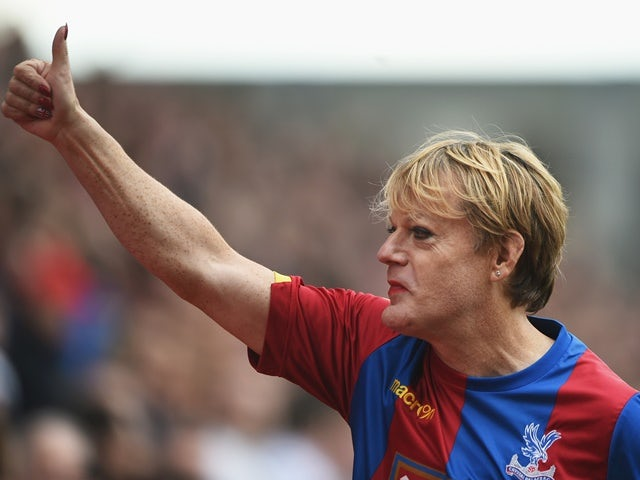 Eddie Izzard presents himself at half time of the Premier League match between Crystal Palace and Norwich City on April 9, 2016