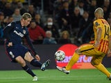 Fernando Torres and Javier Mascherano in actione during the Champions League quarter-final between Barcelona and Atletico Madrid on April 5, 2016