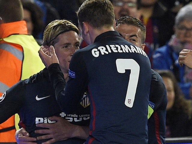A photographer takes an awful picture of Fernando Torres celebrating his goal during the Champions League quarter-final between Barcelona and Atletico Madrid on April 5, 2016